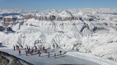 HD: Skiers On The Slope With Spectacular Italian Dolomites In The Background Stock Footage