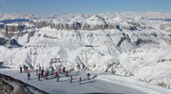 Stock Video Footage of HD: Skiers On The Slope With Spectacular Italian Dolomites In The Background