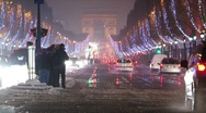 Stock Video Footage of paris by night at champs-élysées-elysees covered in snow