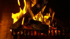 Logs burning in a fireplace - stock footage