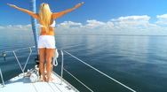 Stock Video Footage of Jet Setting Blonde on Luxury Yacht