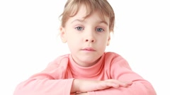 Little girl looks at camera initially sadness, then happy Stock Footage