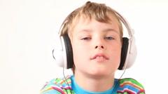 Boy shake his head in earphones Stock Footage