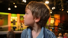Portrait of boy looking around in TV studio Stock Footage