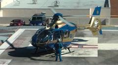 Air ambulance crew doing preflight check  Stock Footage
