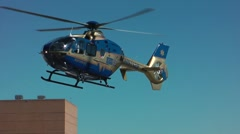 Air ambulance lifts off from hospital helipad  - stock footage