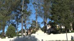 Classic Fountain, Wind in Trees, Blue Sky, Eucalyptus, Pine Stock Footage