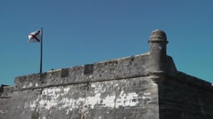 Flag waving on fort wall Stock Footage