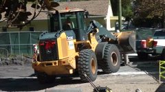 Road construction crew with payloader Stock Footage