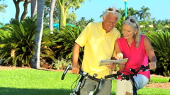 Seniors Cycling Trip Stock Footage