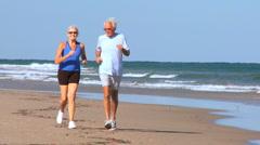 Healthy Seniors Beach Jogging - stock footage