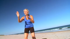 Mature Lady Fun on the Beach Stock Footage
