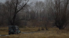 Stock video footage Russian military jeep off-road in the autumn Stock Footage