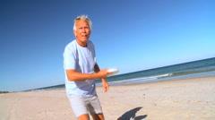 Senior Male Beach Exercise Stock Footage