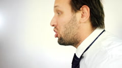 Angry businessman screaming out loud Stock Footage