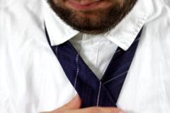 Businessman tying necktie  Stock Footage