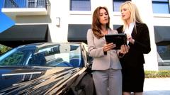 Businesswomen Using Wireless Tablet - stock footage
