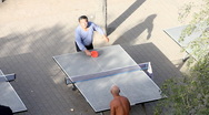 Old man of china play Table tennis in park Stock Footage