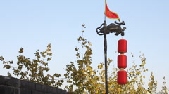 Red dragon flag along and Lantern in the top of Xian City Wall Stock Footage
