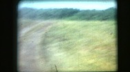 Stock Video Footage of film archival rear POV army trucks in the  dust