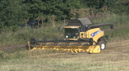 Stock Video Footage of New Holland combine harvester finishes harvesting a field of rapeseed.