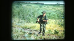 vintage 8mm film, soldier rushes camera with Bren Gun drops and cocks weapon - stock footage