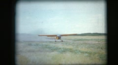 Vintage 8mm film, Canadian Army observer plane takeoff Cessna L-19/O-1 Bird Dog Stock Footage