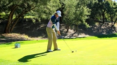 GOLFER RORY MCILROY TEES OF Stock Footage