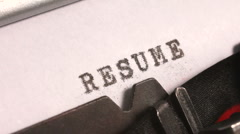 Typing a Resume on an old manual typewriter Stock Footage