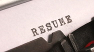 Stock Video Footage of Typing a Resume on an old manual typewriter