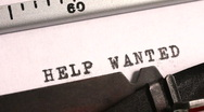 Stock Video Footage of Typing Help Wanted on an old manual typewriter