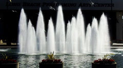 Long Beach Performing Arts Center Fountain Jets Glowing in the Sun (Slowmo) - stock footage