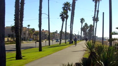 Huntington Beach Bike Rider 1 Stock Footage