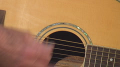 Elderly male hands playing guitar Stock Footage