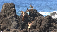 Stock Video Footage of Hawaii Kids on rocks at Laupahoehoe