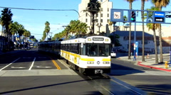 Metro Rail Train Toward Camera In Downtown Area Stock Footage