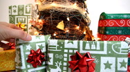 Hand taking presents under modern christmas tree Stock Footage