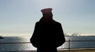 Stock Video Footage of Lone Sailor Looking Out To Sea Statue