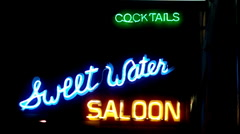 Saloon Neon Sign- Night Stock Footage
