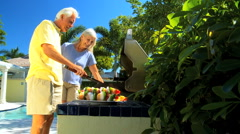 Seniors Grilling Barbeque Food - stock footage