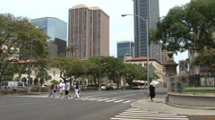 Honolulu crossing street and tall buildings 2 Stock Footage