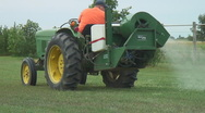 Stock Video Footage of Utility farm tractor sprays pesticides