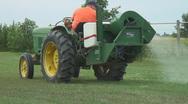 Utility farm tractor sprays pesticides Stock Footage