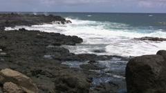 Kauai Waves break on lava rocks - stock footage