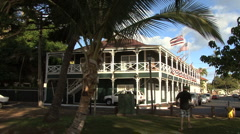 Flags on historic hotel in Lahaina Stock Footage