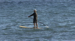 A man paddles a body board  Stock Footage