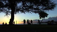 Maui Lahaina People on seawall sunset  - stock footage