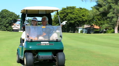 Seniors in Golf Buggy Stock Footage