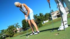 Seniors Golf Success Stock Footage