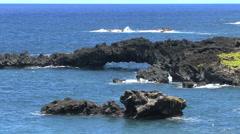 Lava sea arch near Hana on Maui Stock Footage
